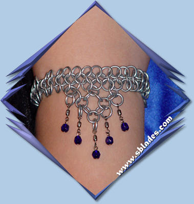 Hexmaile armlet jewelry shown w/steel and cobalt blue beads